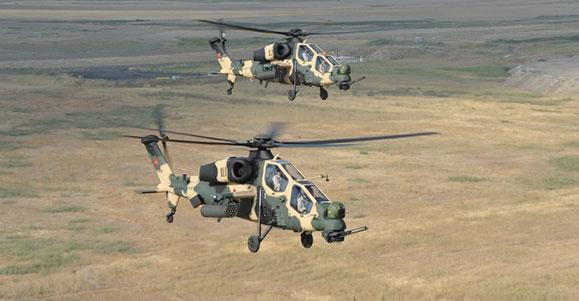 Helicópteros Atak 129 de combate produzidos pela TAI para tática de reconhecimento e ataque